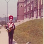 Freshman John Gardner in front of Holmes Sr Building. The Holmes uniform was flashy, colorful and complex, with a cape, cross belt that was the devil to get on correctly, brades and shoe covers.